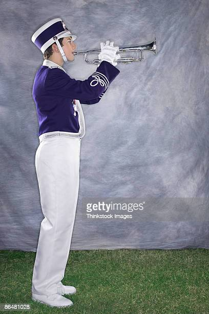 trumpet player in marching band - marching band stock pictures, royalty-free photos & images