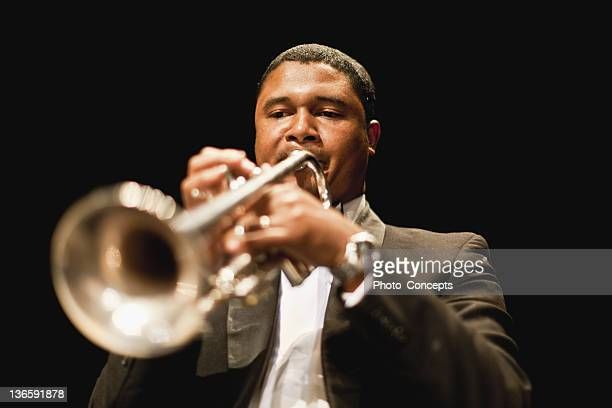 trumpet player in orchestra - trumpet stock photos and pictures