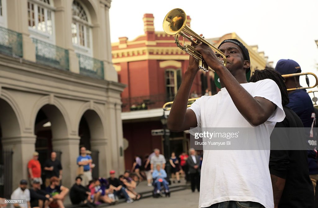 A trumpet player performing on street : Stock Photo