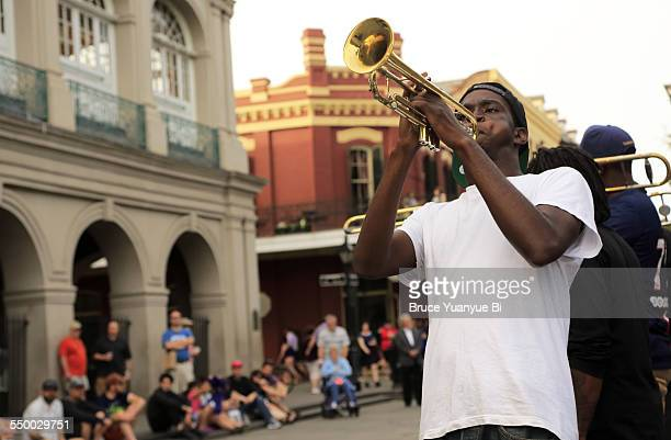A trumpet player performing on street