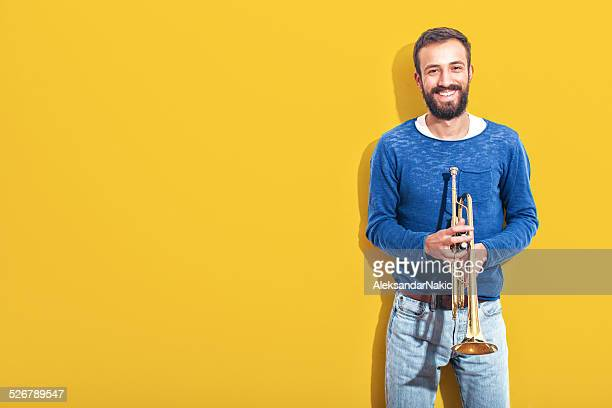 trumpet player - trumpet stock photos and pictures