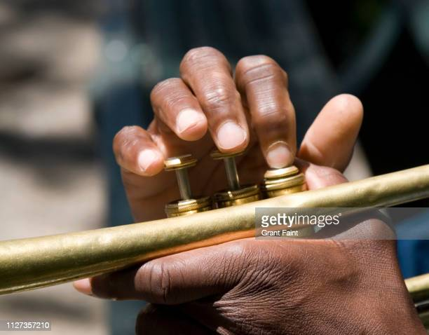 trumpet player's fingers - louisiana stock pictures, royalty-free photos & images