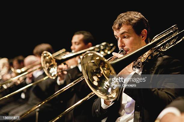 trumpet players in orchestra - musician stock photos and pictures