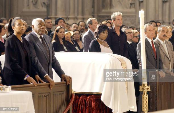 Trumpeter Pedro Knight second left Queen of Salsa Celia Cruz's husband of 41 years stands during her funeral service at St Patrick's Cathedral in New...