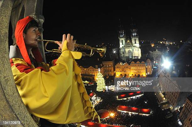 A trumpeter plays during the traditional Christmas tree illuminating and opening of traditional Christmas market in front of the Tyn Church at the...