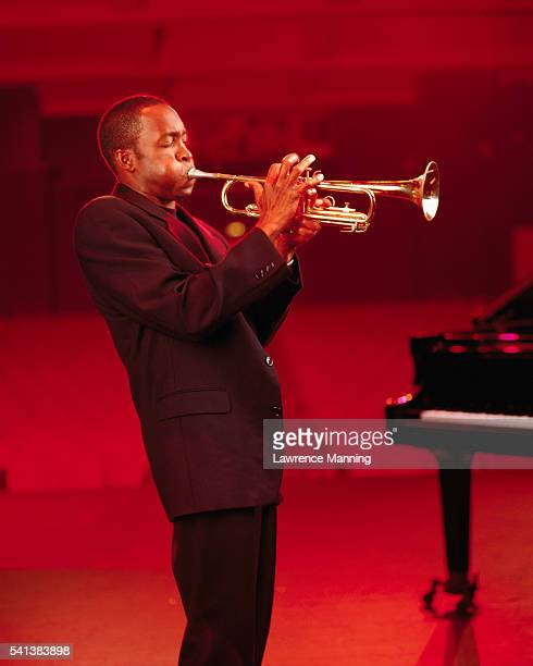trumpeter rehearsing on stage - jazz stock pictures, royalty-free photos & images