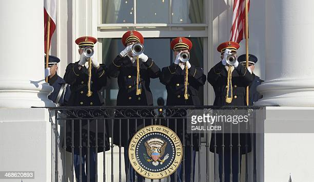 Trumpeters sound the arrival as US President Barack Obama and First Lady Michelle Obama welcome French President Francois Hollande during a State...