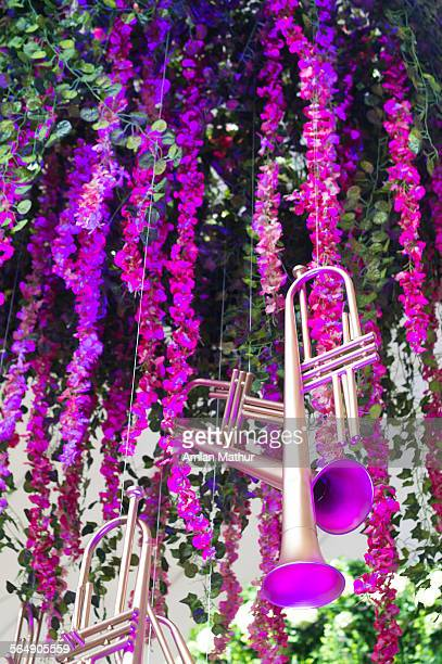 Trumpets against colorful flowers