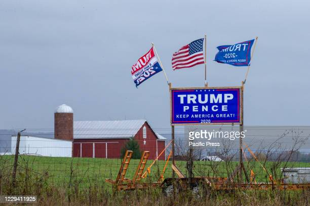 TrumpPence reelection sign and flags are displayed along Interstate 180 in rural central Pennsylvania
