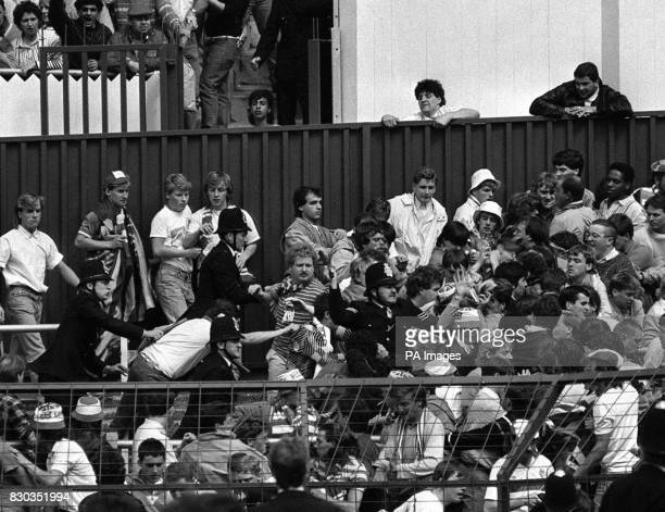 Truncheons at the ready police officers tackle unruly fans of Glasgow Rangers at White Hart Lane ground London where Tottenham Hotspur met Rangers in...