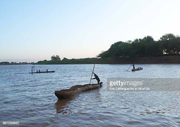 Trunk boats crossing the omo river omo valley omorate Ethiopia on March 16 2016 in Omorate Ethiopia