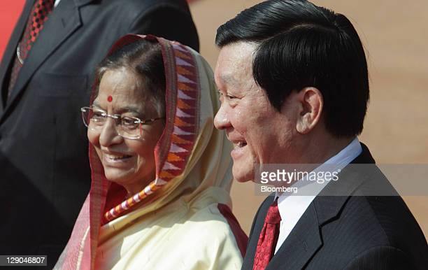 Truong Tan Sang Vietnam's president right and Pratibha Patil India's president attend a welcoming ceremony at the presidential palace in New Delhi...