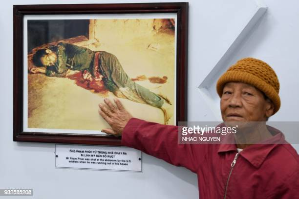 Truong Thi Tri visits the memorial museum for victims of the My Lai massacre in Son My village in Quang Ngai province on March 15, 2018. The...