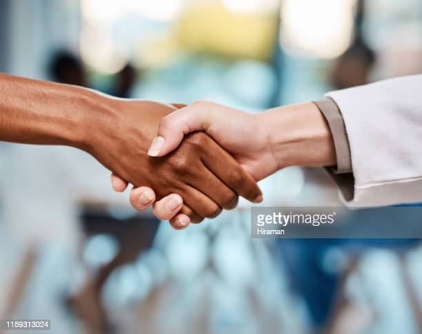 trust is at the heart of reliable healthcare - handshake stock pictures, royalty-free photos & images