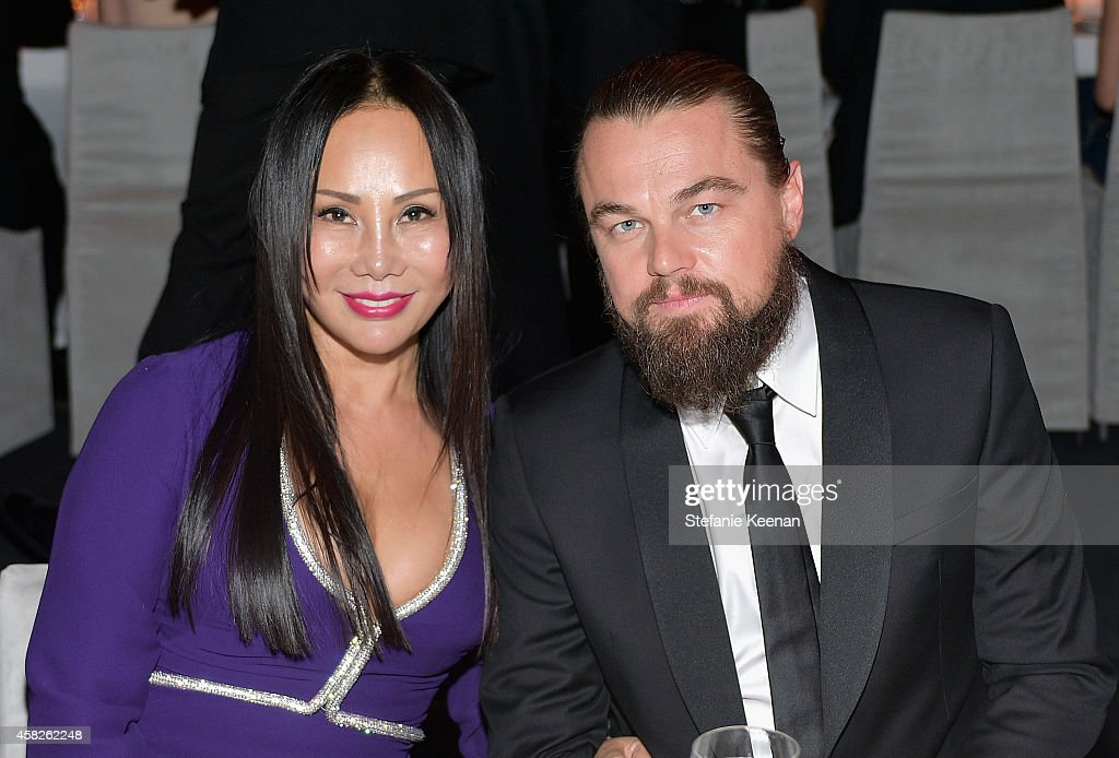 LACMA trustee and gala co-chair Eva Chow, wearing Gucci, (L) and actor Leonardo DiCaprio attend the 2014 LACMA Art + Film Gala honoring Barbara Kruger and Quentin Tarantino presented by Gucci at LACMA on November 1, 2014 in Los Angeles, California.