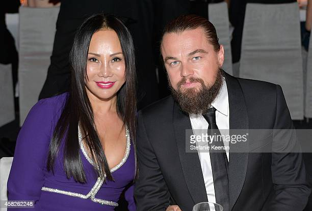 LACMA trustee and gala cochair Eva Chow wearing Gucci and actor Leonardo DiCaprio attend the 2014 LACMA Art Film Gala honoring Barbara Kruger and...