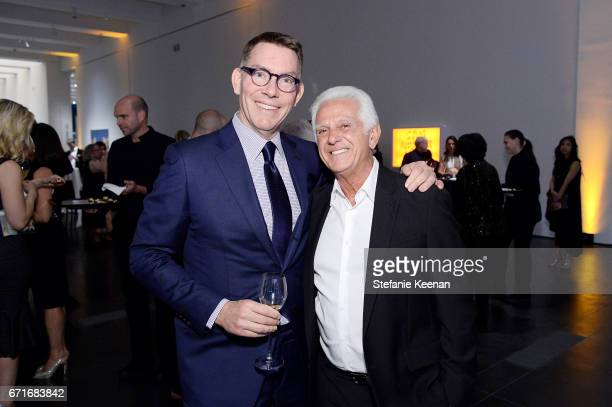 Trustee Kelvin Davis and Maurice Marciano attend LACMA 2017 Collectors Committee Gala at LACMA on April 22 2017 in Los Angeles California