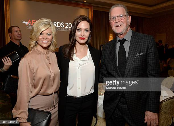 Trustee Leslie Miller actress/director Angelina Jolie and AFI Trustee Rich Frank attend the 15th Annual AFI Awards Luncheon at Four Seasons Hotel Los...