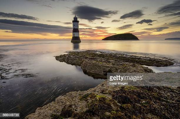 Trwyn Du lighthouse and puffin island at sunrise.