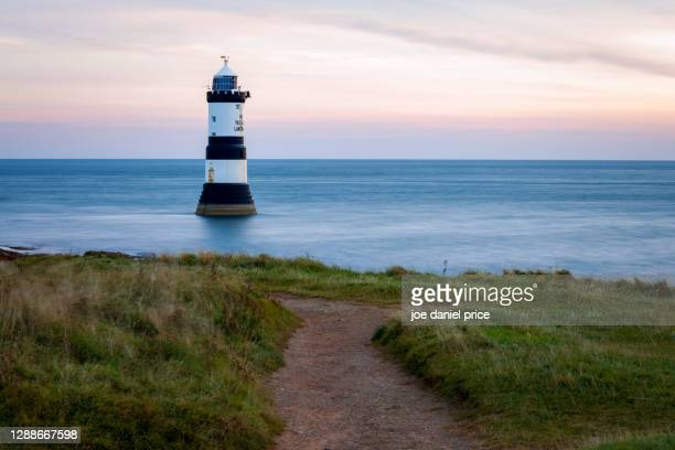 trwyn du lighthouse, penmon point, lighthouse, anglesey, wales - coastline stock pictures, royalty-free photos & images