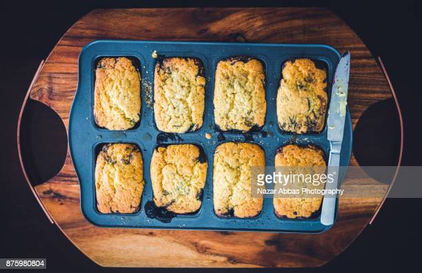 Try full of blueberry cakes on a rustic wooden tray.