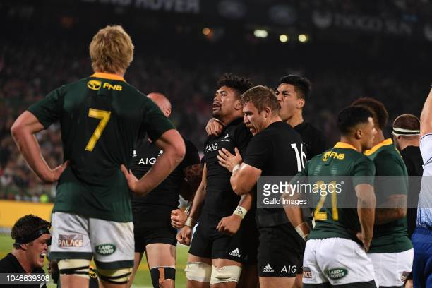 try scorer Ardie Savea celebrates with Nathan Harris of New Zealand during the Rugby Championship match between South Africa and New Zealand at...