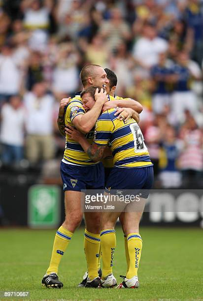 Try scorer Chris Hicks of Warrington comforts team mate Lee Briers as cries with joy on the sound of the final whistle during the semi-final match of...