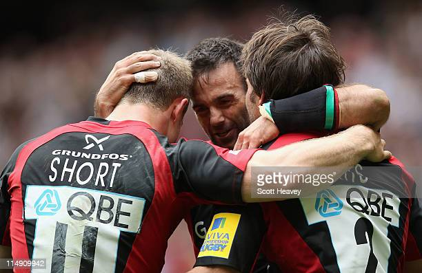 Try scorer James Short Neil de Kock and Schalk Brits of Saracens celebrate the first try during the AVIVA Premiership Final between Leicester Tigers...