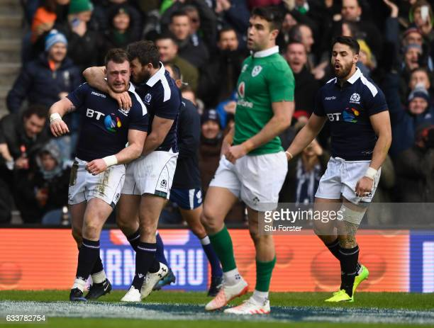 Try scorer Stuart Hogg celebrates after scoring the first try the RBS Six Nations match between Scotland and Ireland at Murrayfield Stadium on...