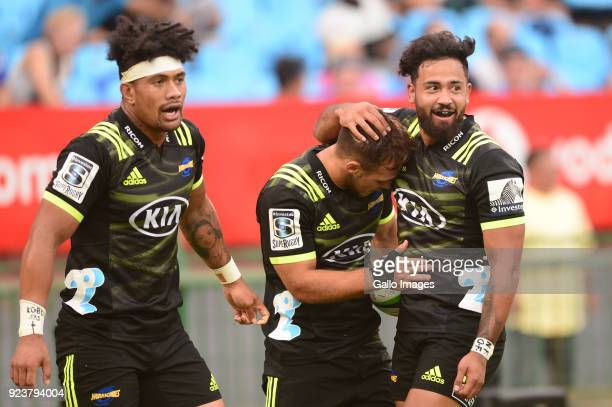 Try scorer Wes Goosen of the Hurricanes celebrates with Matt Proctor of the Hurricanes during the Super Rugby match between Vodacom Bulls and...