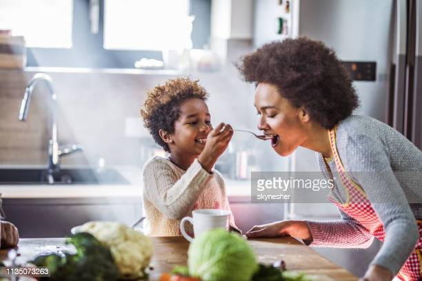 try this mommy! - nutrire foto e immagini stock