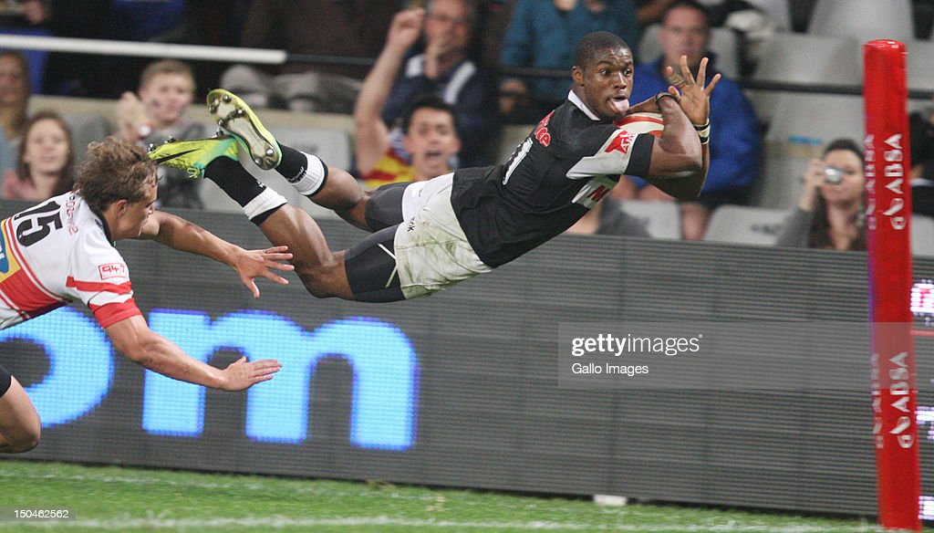 AFRICA - AUGUST 18, Try time Sibusiso Sithole during the Absa Currie Cup match between The Sharks and MTN Golden Lions at Mr Price Kings Park on August 18, 2012 in Durban, South Africa Photo by Steve Haag / Gallo Images