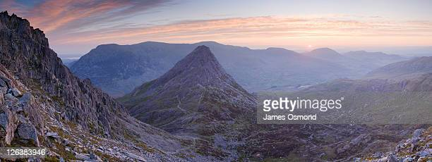 Tryfan at sunrise from the slopes of Glyder Fach. Snowdonia National Park. Conwy. Wales. UK.