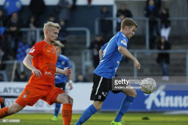 Tryggvi Hrafn Haraldsson of Halmstad BK and Ludvig Ohman Silwerfeldt of Athletic FC Eskilstuna compete for the ball during the Allsvenskan match...