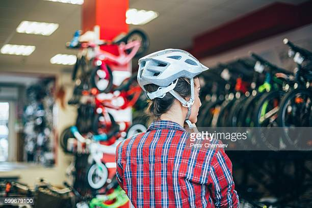 Trying new sports helmet in the bike shop