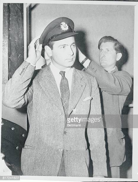 Trying on a cap part of his British European Airways Corporation uniform is Prince Alexander of Yugoslavia 27yearold cousin of exKing Peter and a...