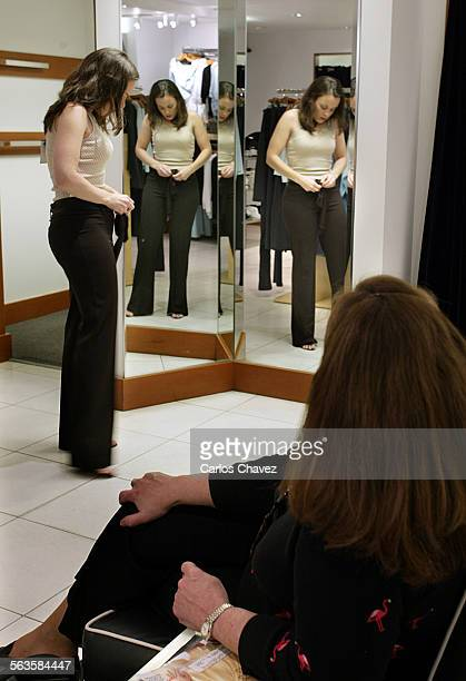 Trying on a few outfits Brechin Polley25 of Indpls as mom Margie Polley looks on at the Bebe Store in Beverly Hills October retail sales for Bebe a...