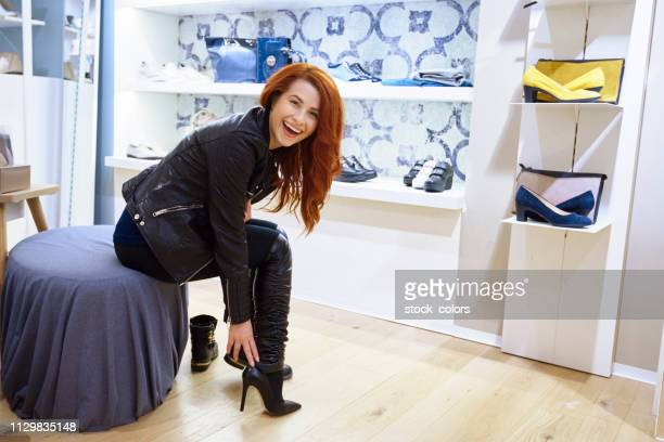 trying shoes inside store - shoe store stock pictures, royalty-free photos & images