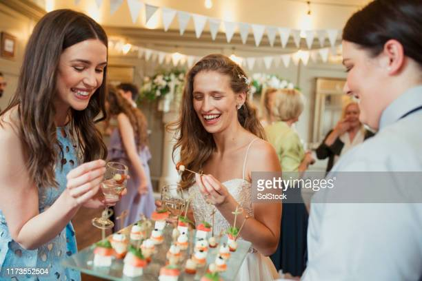 trying the canapés - wedding stock pictures, royalty-free photos & images