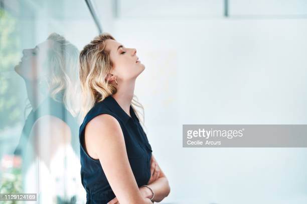 trying to drag herself out of the doom and gloom - blonde hair stock pictures, royalty-free photos & images