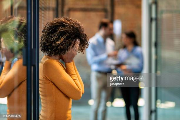 trying to drag herself out of the doom and gloom - being fired stock pictures, royalty-free photos & images