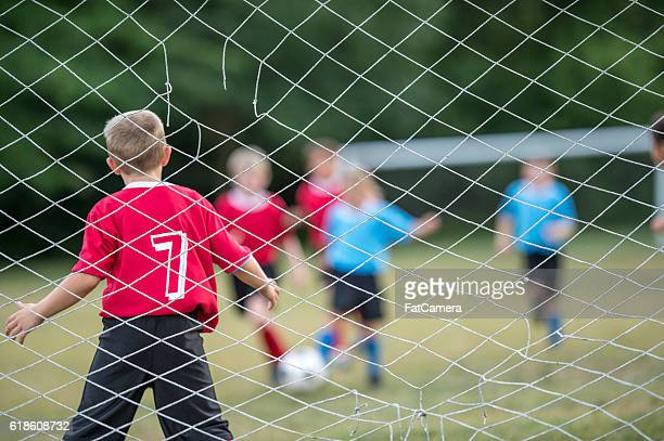 trying to score a goal - fat goalkeeper stock pictures, royalty-free photos & images