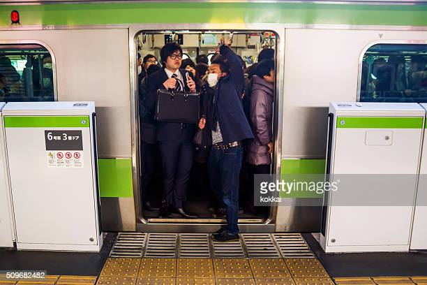Trying to squeeze on the train in Tokyo