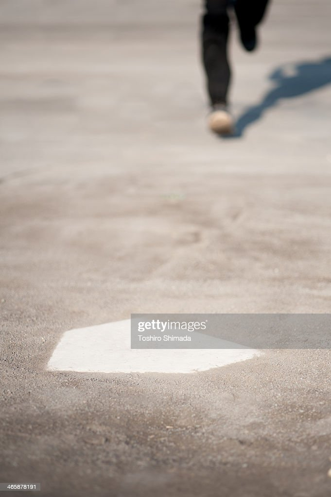 Trying to step the home base : Stock Photo