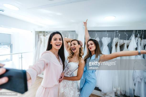 trying wedding dress - bridesmaid stock pictures, royalty-free photos & images