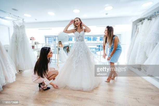 trying wedding dress - wedding dress stock pictures, royalty-free photos & images
