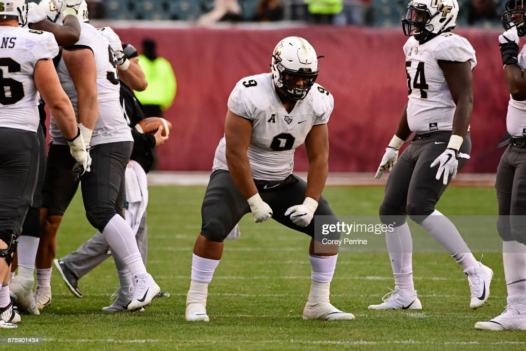 Trysten Hill #9 of the UCF Knights flexes after a defensive stop during the third quarter against the Temple Owls at Lincoln Financial Field on November 18, 2017 in Philadelphia, Pennsylvania. UCF defeated Temple 45-19.