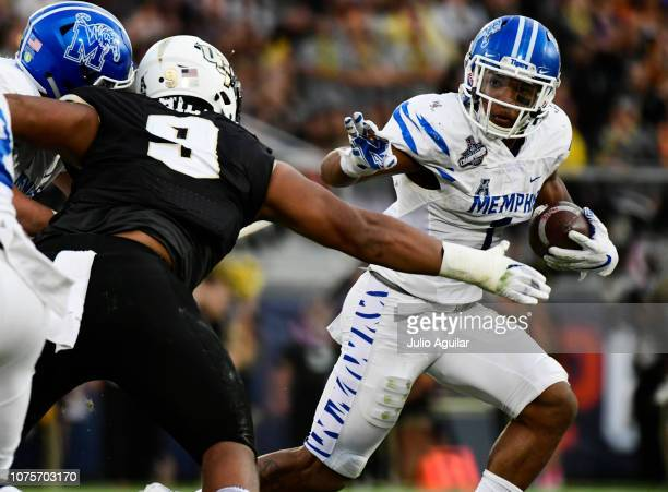 Trysten Hill of the UCF Knights takes down Tony Pollard of the Memphis Tigers for a loss of two yards during the first quarter of the American...