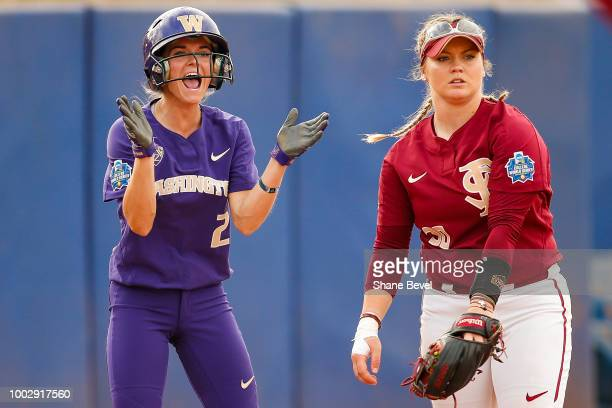 Trysten Melhart of Washington left cheers after reaching third base during the Division I Women's Softball Championship held at USA Softball Hall of...