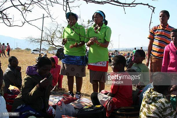 Tsabile Dlamini and fellow peer educator talks to a group of girls about sex and the benefits of abstinence during the traditional Umhlanga ceremony...